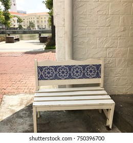 Peranakan tiled bench in the shade in Singapore next to the river at Boat Quay
