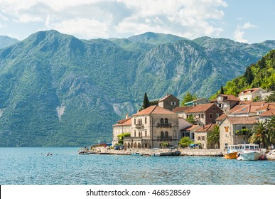 Perast embankment with houses and boats in Kotor bay in Montenegro with soft focus