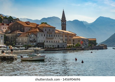 Perast, Kotor Municipality / Montenegro - September 19 2018:  Tourists walk along the promenade
