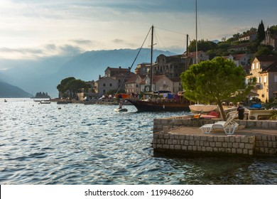 Perast, Montenegro - 09/22/2018: View of Perast and the Bay of Kotor at early autumn, lit up by the sunset. Cityscape, background.