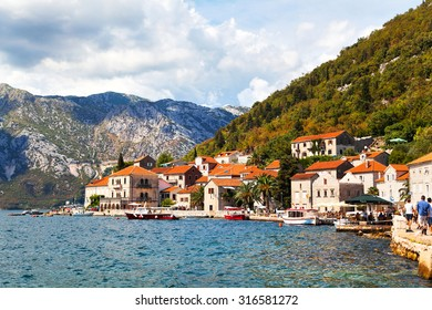 PERAST, MONTENEGRO - 19 AUGUST 2015 - An idyllic town on the Bay of Kotor in Montenegro; In the bay there are two islets: St. George and Our Lady of the Rocks, each has a picturesque chapel