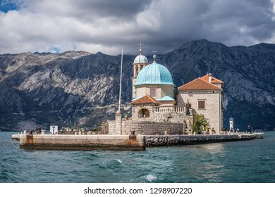 Perast, Montenegro - April 2018 : Our Lady on the Rocks and small Church on San George`s island in Kotor Bay