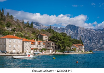 Perast, Montenegro - April 2018 : Small motor boat on the shore in the beautiful Perast town in the Kotor Bay