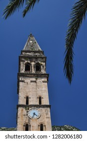 Perast, Montenegro Aug 2016: Saint Nikola Church bell and watch tower in Perast, Kotor harbour, Montenegro