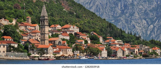 Perast/ Montenegro Aug 2016: Scenic panorama view of the historic town of Perast located at world-famous Bay of Kotor on a beautiful sunny day  in summer, Montenegro