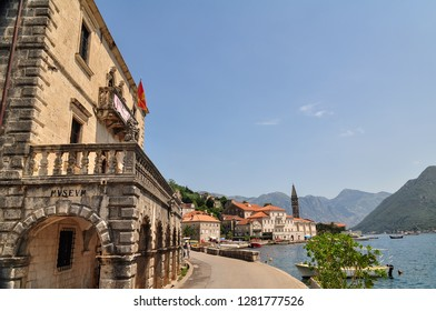 PERAST. MONTENEGRO - AUGUST, 2016. Beautiful View ancient city of Perast is located in Boka Kotorska Bay of the Adriatic sea on Sunny summer day. Tourists walk along the promenade of Perast