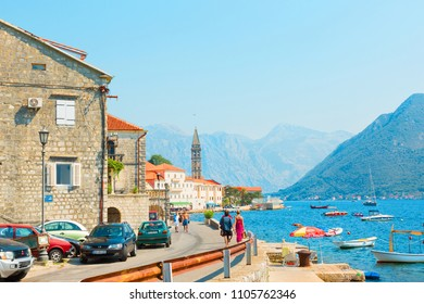 PERAST. MONTENEGRO - AUGUST, 2017. Beautiful View ancient city of Perast is located in Boka Kotorska Bay of the Adriatic sea on Sunny summer day. Tourists walk along the promenade of Perast