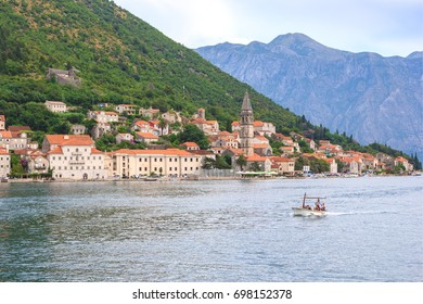 PERAST, MONTENEGRO - AUGUST 6, 2014: View of Perast city from sea side. Perast is beautiful town on coast of Montenegro and located on the Bay of Kotor