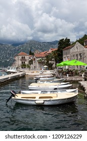 PERAST, MONTENEGRO - CIRCA JUN, 2016: Private motor boats are moored in Perast city port. Vessels are available for small cruise to islet in Kotor bay to island of Gospa od Skrpjela, Adriatic sea