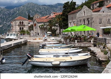 PERAST, MONTENEGRO - CIRCA JUN, 2016: Private motor boats are moored in Perast town port. Vessels are available for small cruise to island of Gospa od Skrpjela in Kotor bay, Adriatic sea