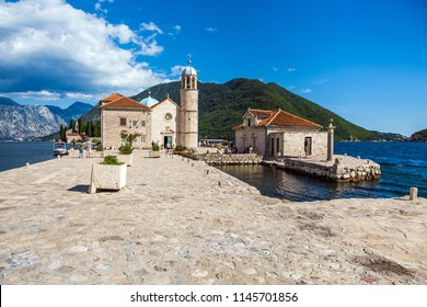 Perast, Montenegro - July, 2018: Small islet near Perast city in Montenegro with he roman catholic Church of Our Lady of the Rocks