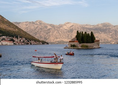 PERAST, MONTENEGRO - JULY 22, 2018: Our Lady of the Rock and St.George Island in Perast on shore of Boka Kotor bay, Montenegro during Fashinada (Fasinada) -  is an ancient folk holiday of Boka Kotor