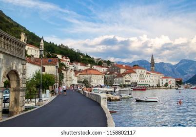 PERAST, MONTENEGRO - July 25, 2018: People walk on a promenade in popular resort town Perast, Montenegro