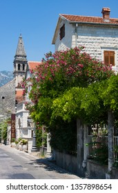 PERAST, MONTENEGRO - July 8, 2015: Promenade with old buildings and hotel, in Perast, Montenegro