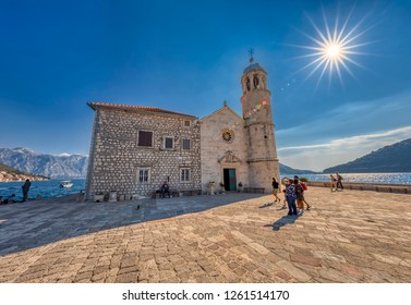 PERAST, MONTENEGRO - OCTOBER 20, 2018: The Gospa od Skrpjela (Our Lady of the Rocks) island's church is seen on October 20, 2018 in Perast, Montenegro.