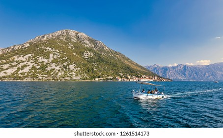 PERAST, MONTENEGRO - OCTOBER 20, 2018: The town is seen from Gospa od Skrpjela (Our Lady of the Rocks) island on October 20, 2018 in Perast, Montenegro.