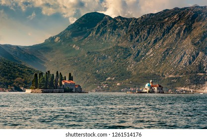 PERAST, MONTENEGRO - OCTOBER 20, 2018: The Gospa od Skrpjela (Our Lady of the Rocks) island (r) ant the Sveti Dordje(St. George) island (l) are seen in Perast, montenegro.
