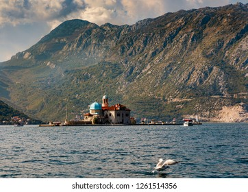 PERAST, MONTENEGRO - OCTOBER 20, 2018: (EDITORS NOTE: Image has been digitally enhanced.) The Gospa od Skrpjela (Our Lady of the Rocks) island is seen from a boat on October 20, 2018 in Perast, Monten