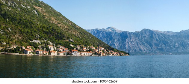 Perast, Montenegro. The old european city and mountain in rays of sunset