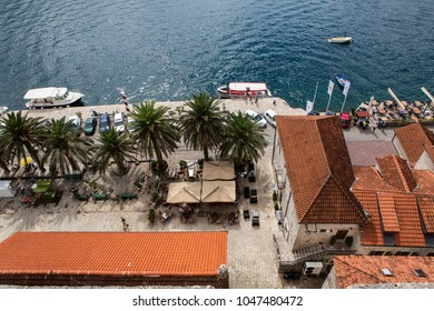 Perast, Montenegro - September 12: roofs of old houses in Perast and Bay with mountains in Montenegro in the European day of languages on September 12, 2017