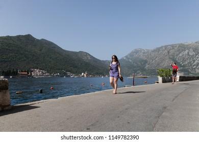 PERAST, MONTENEGRO - SEPTEMBER 17, 2015: People in the old harbor of Perast, Montenegro
