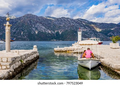 PERAST, MONTENEGRO - SEPTEMBER 21: This is pier with a small boat in the seaside town of Perast in the Bay of Kotor on September 21, 2016 in Perast