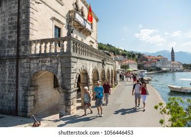 PERAST, MONTENEGRO - SEPTEMBER 27, 2016: People walk on a promenade near Museum in popular resort town Perast, Montenegro