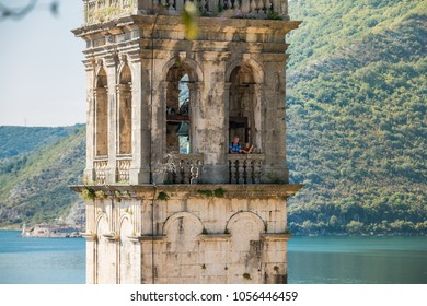 PERAST, MONTENEGRO - SEPTEMBER 27, 2016:  People on a bell tower of St. Nicholas Church in Perast, Montenegro