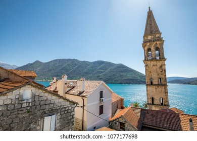 Perast, Montenegro showing the tower, the sea, and the mountains