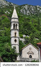 PERAST, MONTENEGRO-AUG, 2016: Cityscape of Perast town with ancient houses and St Nicholas church. It is situated at foot of St. Elijah Hill, opposite Verige strait. The Kotor Bay, Adriatic sea