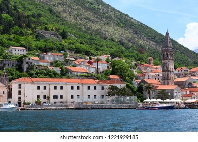 PERAST, MONTENEGRO-CIRCA JUN, 2016: Bank of Perast town with ancient houses and St Nicholas church. It is situated at foot of St. Elijah Hill, opposite Verige strait. The Kotor Bay, Adriatic sea