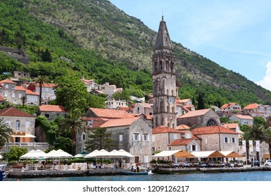 PERAST, MONTENEGRO-CIRCA JUN, 2016: Cityscape of Perast town with ancient houses and St Nicholas church. It is situated at foot of St. Elijah Hill, opposite Verige strait. The Kotor Bay, Adriatic sea