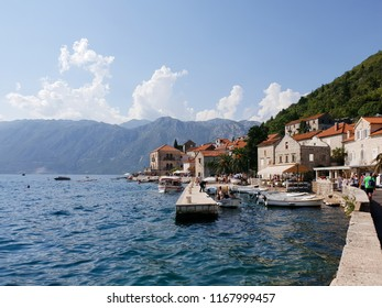 Perast/Montenegro - August 13, 2018: View of the embankment of Perast, coast of the Bay of Kotor in Montenegro, medieval buildings on the beach