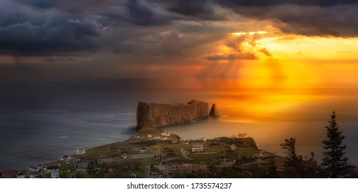 Perce, Quebec, Canada. Aerial Panoramic View of a Small Town on the East Atlantic Ocean Coast. Dramatic Sky Sunrise Composite.