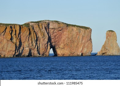 "Perce Rock (French rocher Perce, ""pierced rock"") is a huge sheer rock formation in the Gulf of Saint Lawrence on the tip of the Gasp�© Peninsula in Quebec, Canada, off Perce Bay"