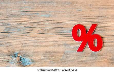 percent discount icon symbol on a wooden background