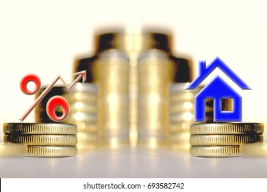 The percent symbol ?nd real estate and on the background of bars coins . The concept of mortgage lending