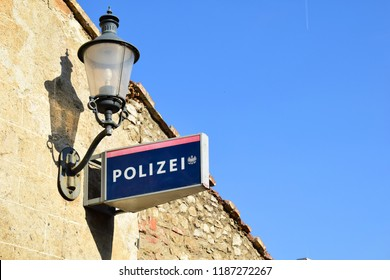 PERCHTOLDSDORF, AUSTRIA - SEPTEMBER 21, 2018: Sign for Austrian Federal Police and an old street lamp in Perchtoldsdorf, a town in Niederösterreich (Lower Austria)