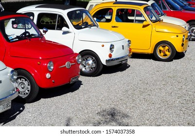 Percoto,Italy. March 24 2019. Bright vintage  colorful Fiat 500s   waiting to participate in an auto gathering later