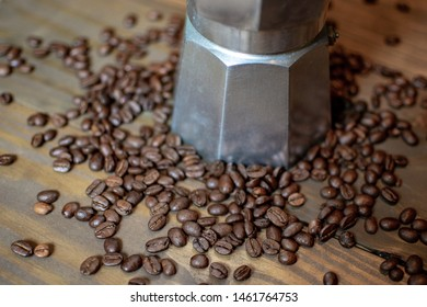 A Perculator with coffee beans