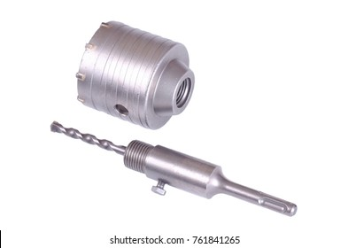 Percussion core hammer drill bit for cutting holes into base materials.