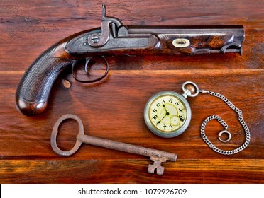 Percussion pistol made around 1840 with pocket watch and skelton key.