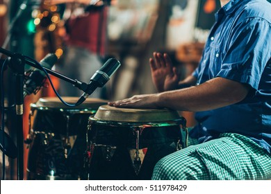 Percussionist playing drums on concert