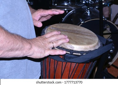 the percussionist plays the ashiko drum with his hands