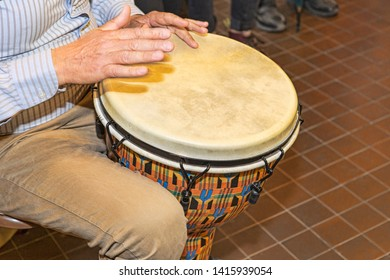 The percussionist uses the bongo to rhythm the song