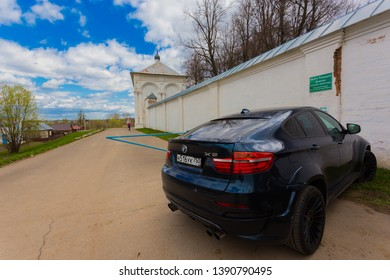 Pereslavl-Zalessky, Russia - May 3, 2019 :BMW x6 parked near Holy Trinity Danilov monastery in the city of the Golden ring Pereslavl Zalessky