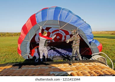 Pereslavl-Zalessky, Russia - September 23, 2017: Crew of a hot air ballon preparing before flight at the festival of aeronautics in Pereslavl-Zalessky