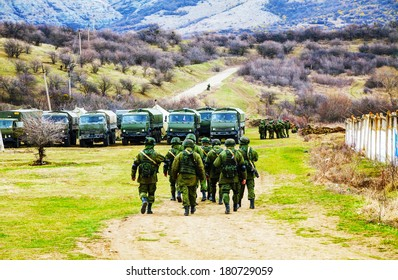 PEREVALNE, UKRAINE - MARCH 5: Russian soldiers marching on March 5, 2014 in Perevalne, Ukraine. On February 28, 2014 Russian military forces invaded Crimea peninsula.