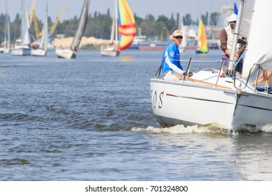 PEREYASLAV, UKRAINE- AUGUST 5, 2017: Boat in sailing regatta Cup of Pereyaslav on a bright sunny day