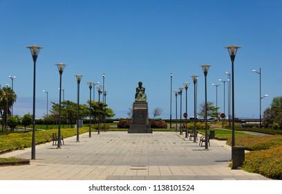 Perez Galdos statue in Las Palmas city on sunny day. Spanish novelist popular sculpture in park of Gran Canaria, Spain